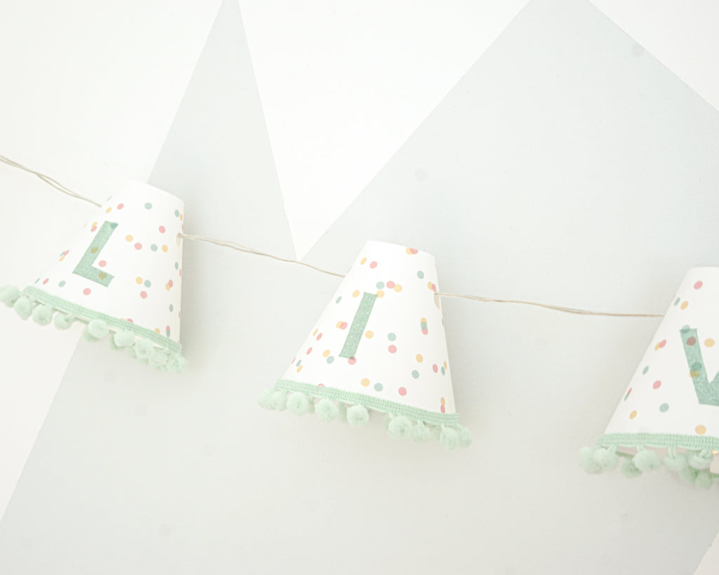 Personalised pom pom fairy lights in green