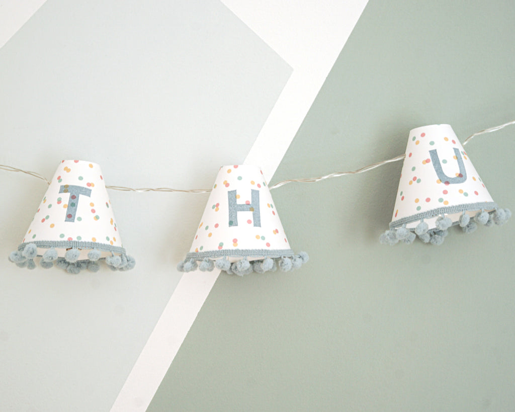 Personalised pom pom fairy lights in blue