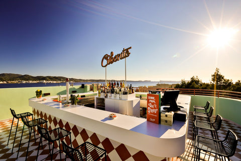 Grab yourself a Havana cigar and a glass of rum and enjoy the sunset from the rooftop bar at Cubanito Hotel in Ibiza