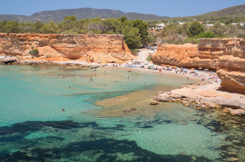 With red cliffs and crystal clear waters Sa Caleta is a stunning and secluded beach