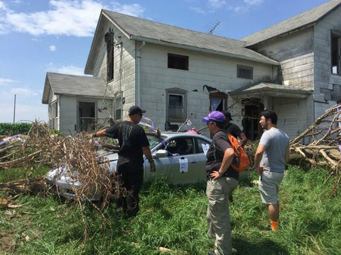 The team strategizing outside the damaged home