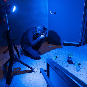 FoxFury Nomad® Forensic Blue 470nm Area Light and Spotlight - all-weather and waterproof light source stows compactly for easy storage and transport. Shown on a crime scene training