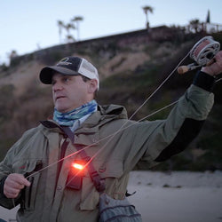 FoxFury Scout Tac White & Red LED Utility Light - Durable and versatile light has both white and red LEDs. It's waterproof and fire resistant. Shown hooked to a jacket for fishing