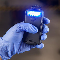 The FoxFury Scout 470nm Blue Forensic Light System helps in visualizing fluorescence / absorption in evidence. Shown handheld