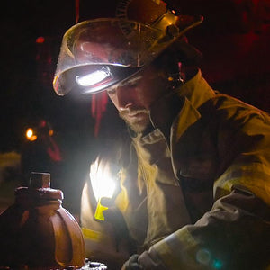 FoxFury Command+ Tilt White LED Headlamp / Helmet Light - Panoramic light bar is 100 lumens and has True to Life™ LED technology. Impact and fire resistant. Shown on a fire fighter wearing a helmet with external face shield.