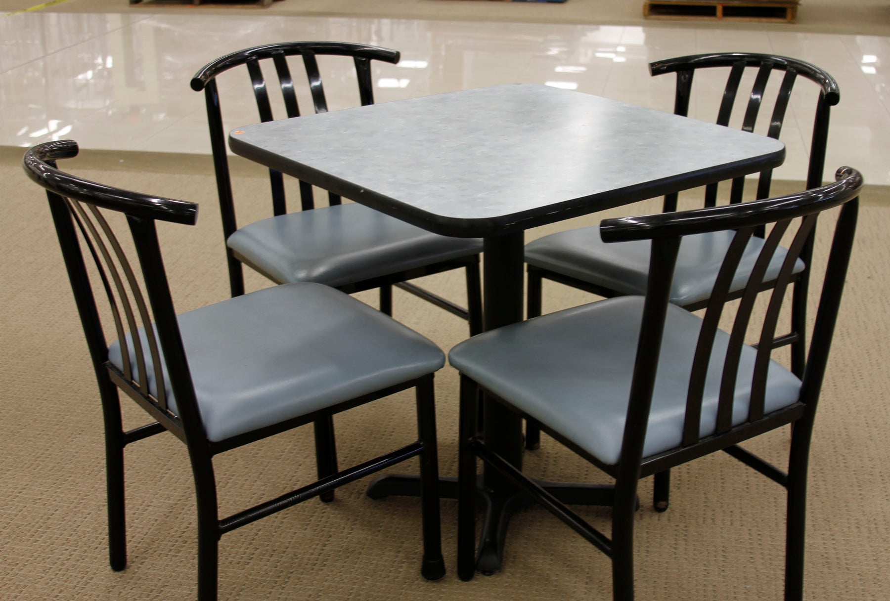 4-Seat Laminate Table with Matching Tubular Steel Padded Chairs