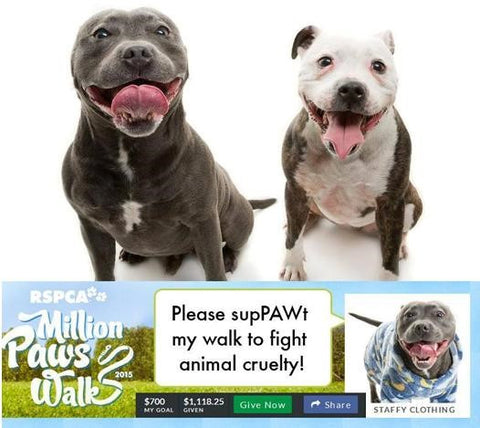 Miley and Denzel showing the amount of money staffy clothing raised for Million paws walk