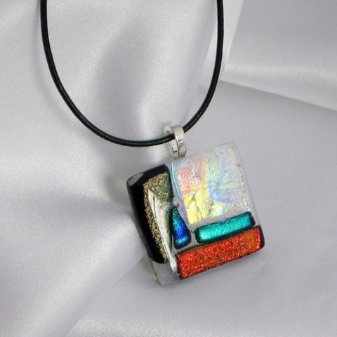 Multicolored geometric with colors of opal, gold, blue, green, black, and red.