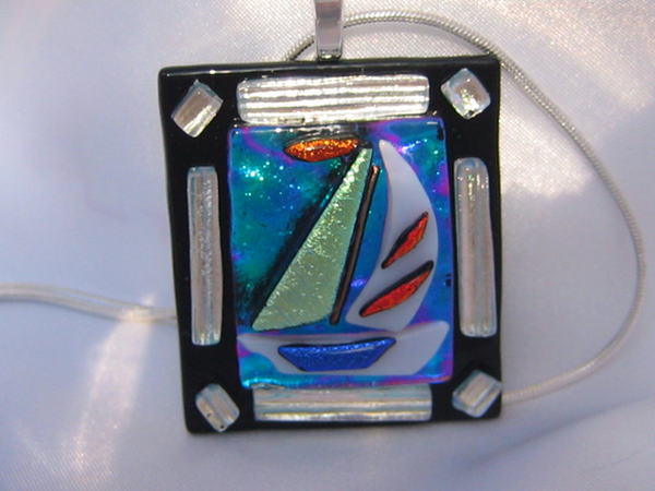 Pendant measures: 1 3/4 inches long x 1 1/2 inches wide. Length including the bail: 2 1/4 inches