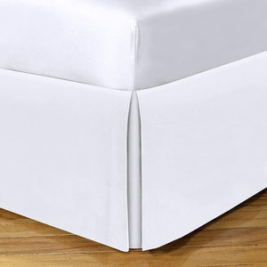 White bed skirt with split corners