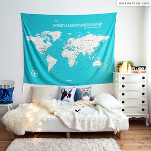UMade; large turquoise travel map of the world hanging in the living room gives off a dymanic vibe! Plan your travels on UMap personalized world map.