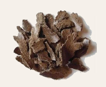 Dark brown shavings of Butter Tree Bark