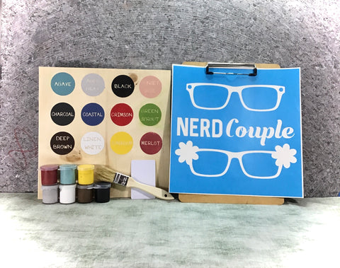 Nerd couple with glasses and flour DIY Sign painting kit