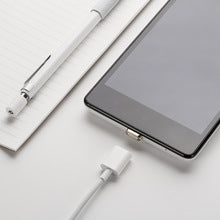 Magnetic Lightning Cable for iPHone photo of phone and cable connecting