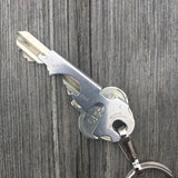 Keychain multitool with tweezers