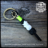 Mini keychain with carved wooden or bone skull