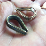 Handcast brass teardrop thimbles for paracord