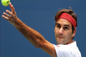 Stylish Roger Federer close up tossing ball for serve