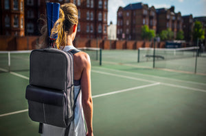 Epirus backpack with leather grip covers on tennis court