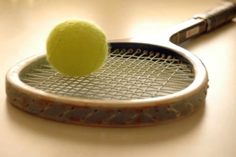 Real Court Tennis racket with ball