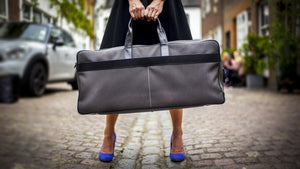 Lifestyle shot of Epirus weekend bag on London street