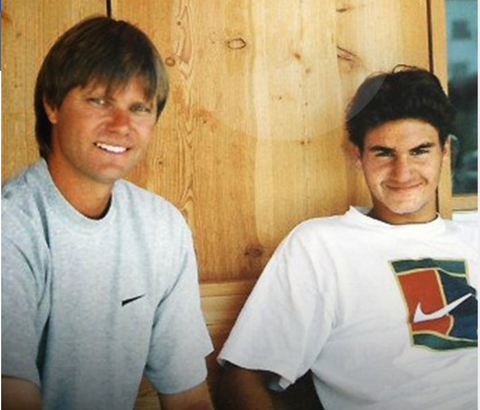 Peter Carter and Roger Federer on a tennis court