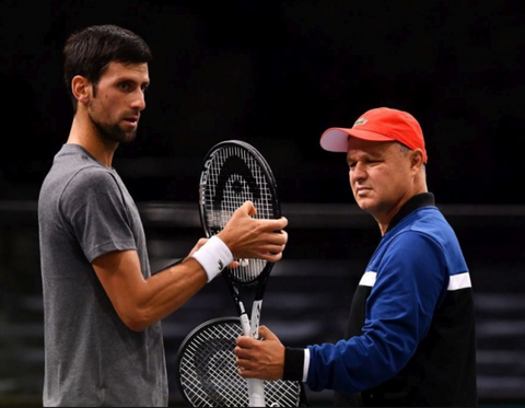 Vajda and Djokovic on the court