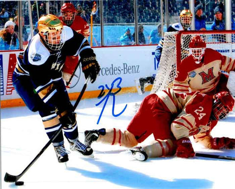 Bryan Rust Autographed ND Passing Puck 8x10