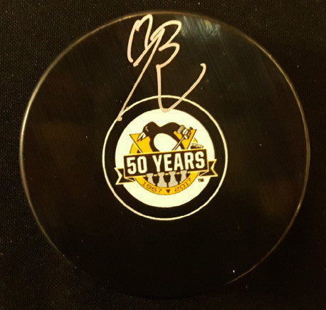 Bryan Rust Autographed 50th Anniversary Logo Puck