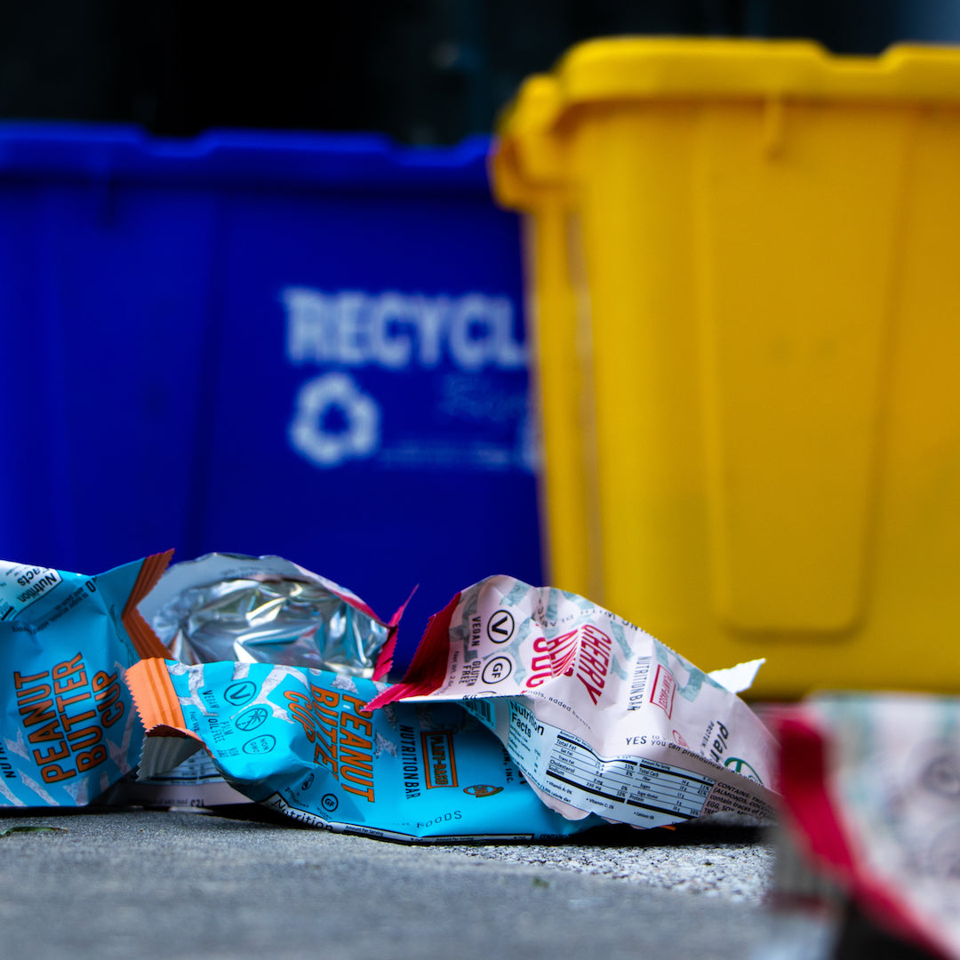 recycling bins with open wrappers near