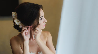 How to Pick Wedding Earrings That'll Complement Your Dress