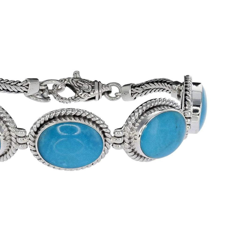 Oval Arizona Turquoise Bracelet with Sterling Silver Detail