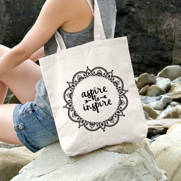 Aspire to inspire positive message tote bag.