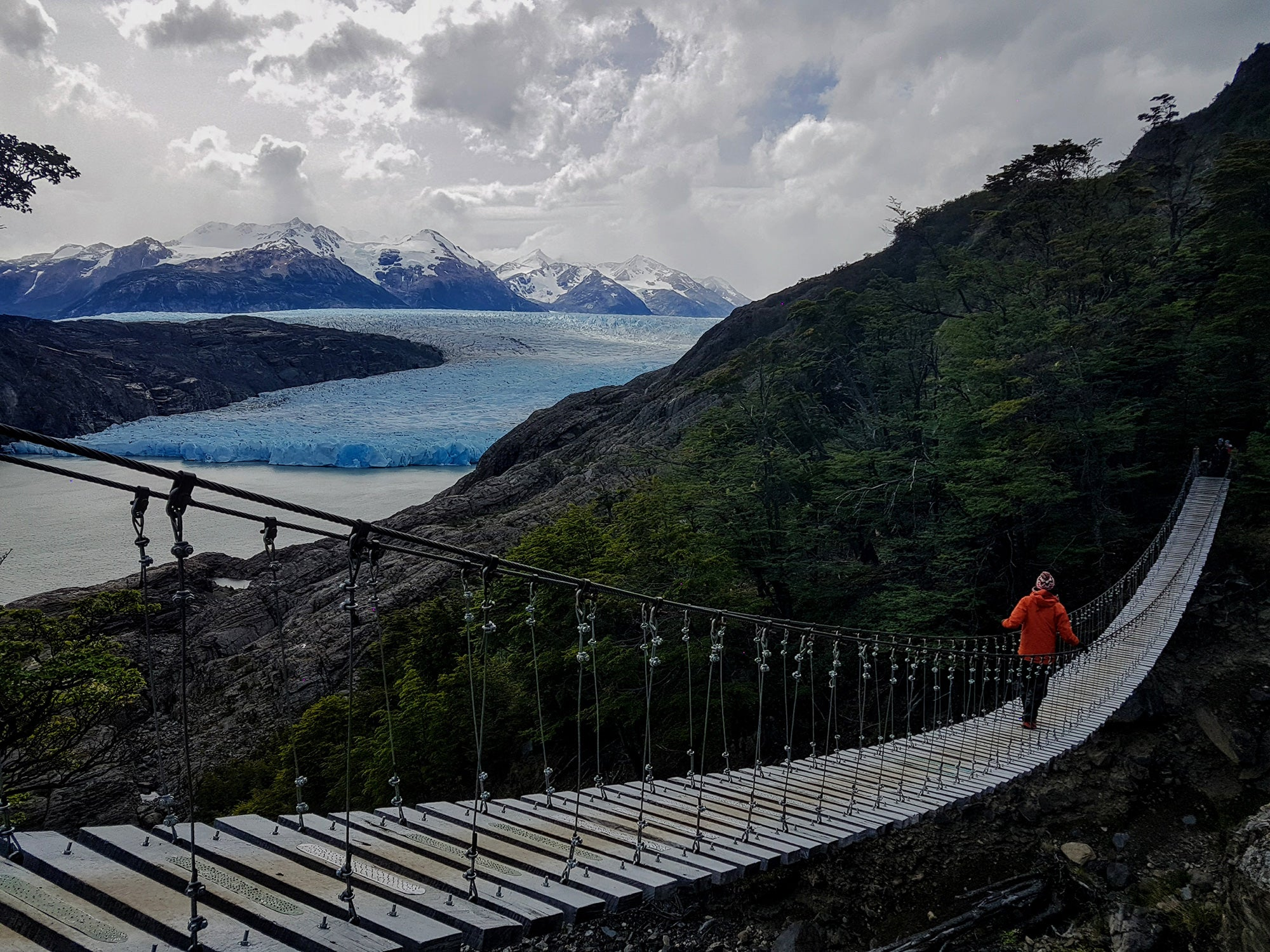 wooden bridge near a glacier