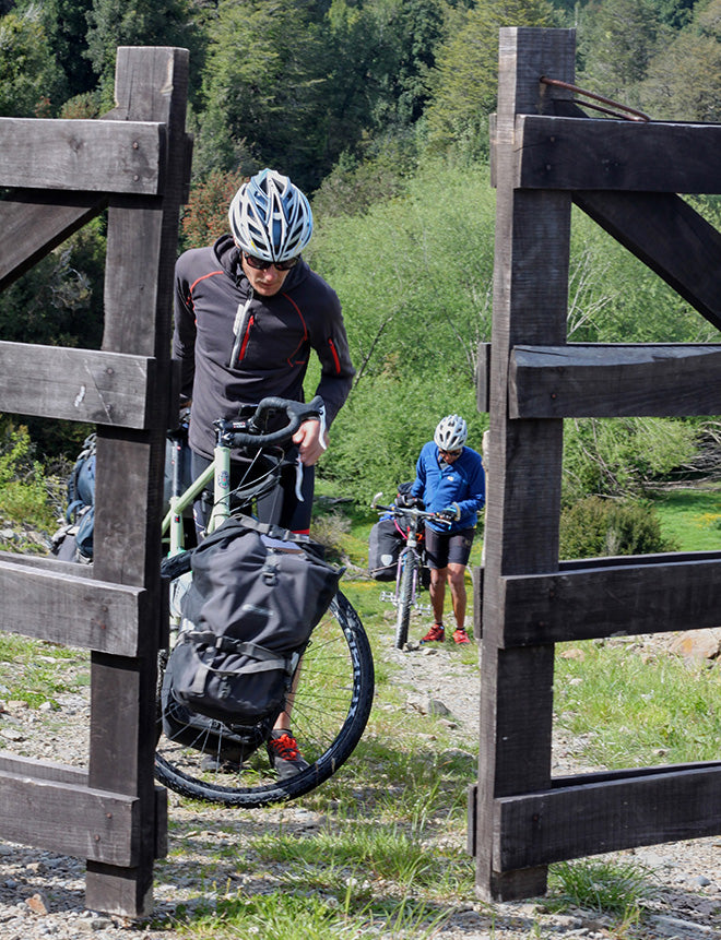 bicycles riders passing through a gate