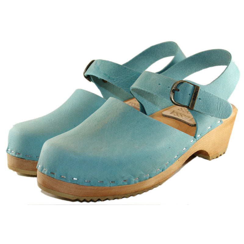 Classic Swedish clog style aqua distressed leather on a traditional wood heel
