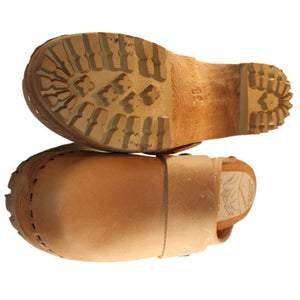 Tan mountain clog with wide snap strap
