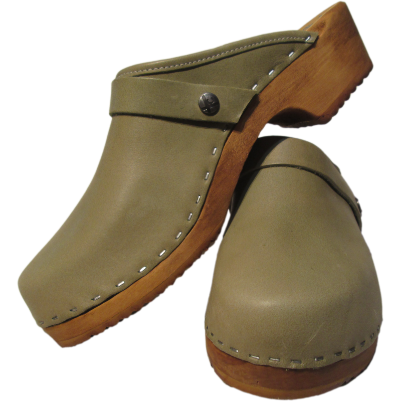 a pair of sage green clogs, green clogs, traditional heel clogs