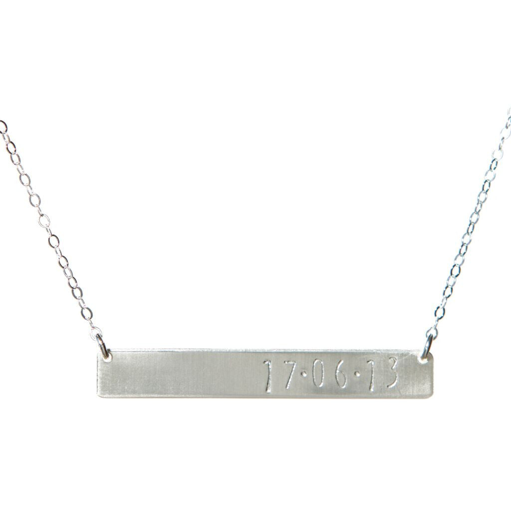 with women date her necklace for anniversary roman numerals