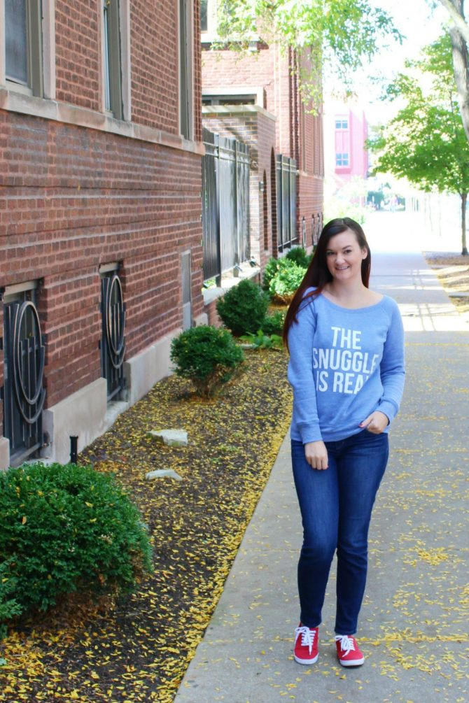 "Blogger, Lindzi Shanks, wears a cozy blue sweater that says ""The Snuggle is Real""."