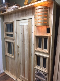 A display showing various windows types, a sauna, and one of our beautiful sconces. All handmade in Sudbury Ontario by Sudbury Cedar Products.