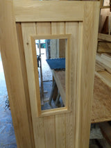 "Cedar door with glass measuring 24"" x 74"""