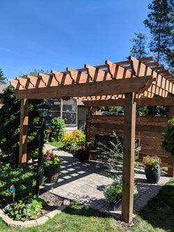 10x10 pergola is great for enhancing your back yard space.