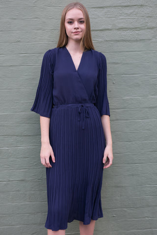 Side view of purple crossover pleated work dress
