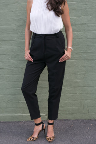 Front view of black high waisted crop work pants