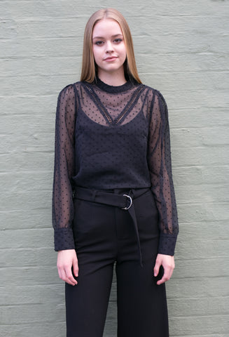 Front view of black sheer work blouse and black pants