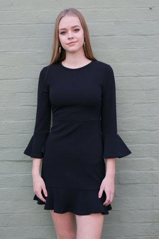 Front view of black bell sleeve work dress with flared hem