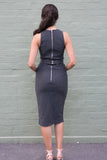 Back view of dark grey pin stripe sleeveless work dress with zipped back