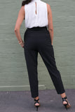 Back view of black high waisted crop work pants