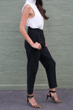 Side view of black high waisted crop work pants